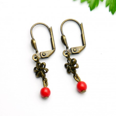 Aged bronze pendant earrings with a red glass bead  Basic 15,00 €