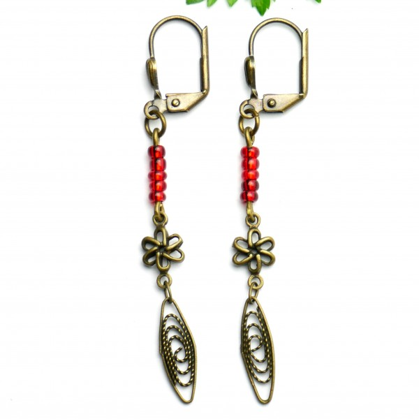 Aged bronze pendant earrings with a red glass bead  Basic 19,00 €