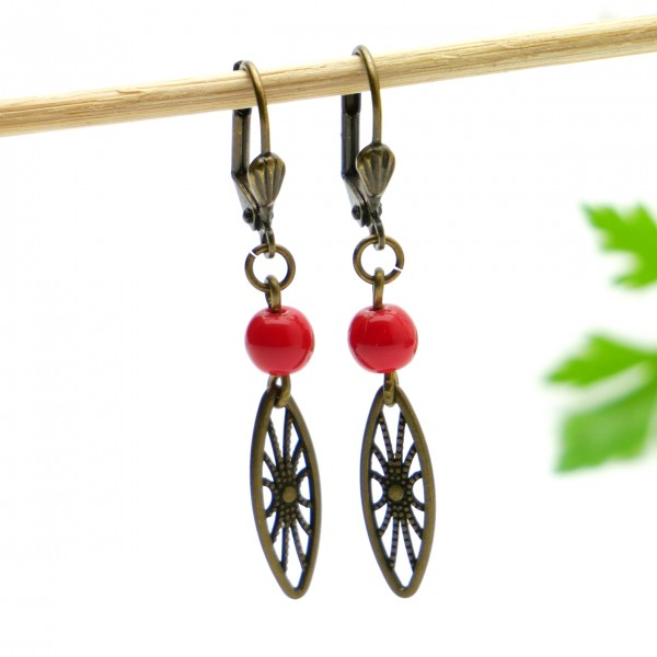 Aged bronze pendant earrings with a red glass bead Earrings 17,00 €