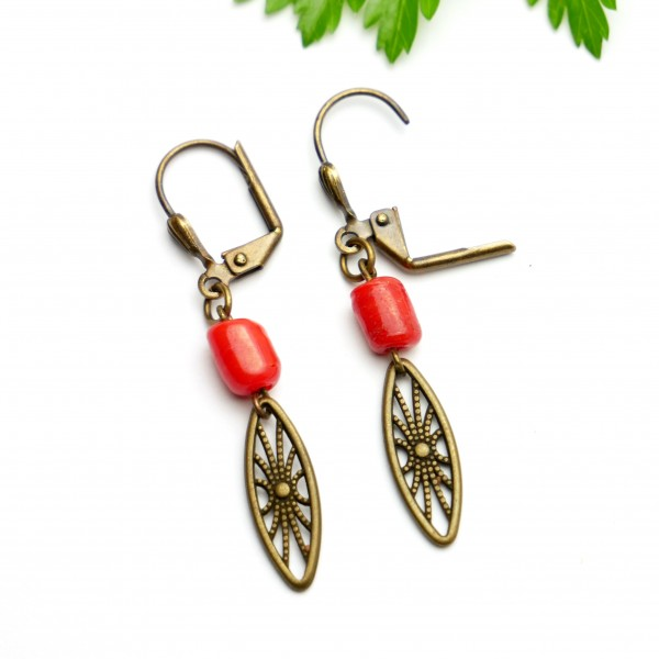 Aged bronze pendant earrings with a red glass bead Earrings 17,00€