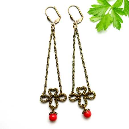 Aged bronze pendant earrings with a red glass bead  Basic 27,00€
