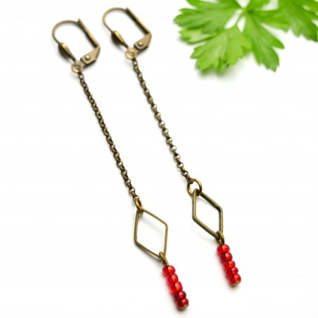 Aged bronze pendant earrings with a red glass bead  Basic 25,00 €